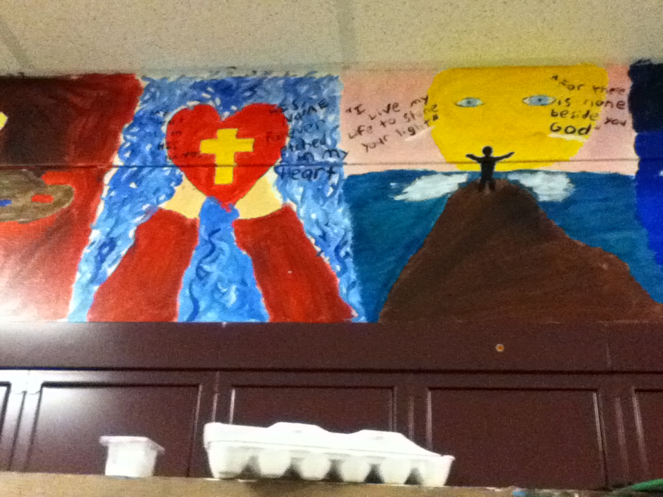 Mural of cross and heart with scripture verses